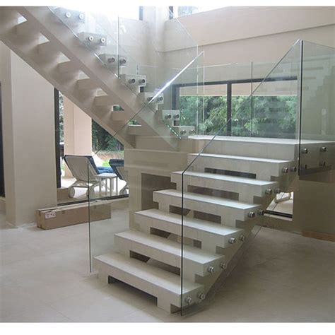 frameless glass railing system with standoff bracket for