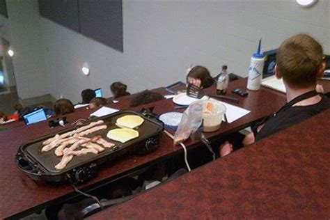 college student cooks breakfast in class, bacon and