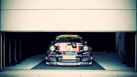 1366x768 racing porsche in the garage desktop pc and mac