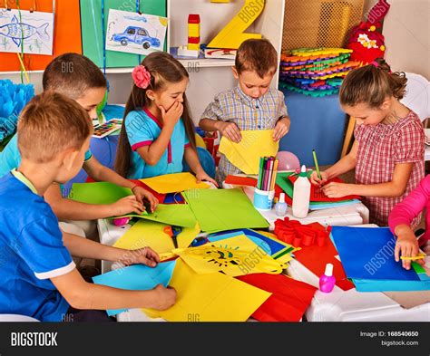 Paper With Children - child cutting paper in class development and social
