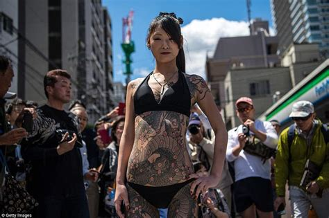 japanese tattoo underwear yakuza tattoos on show as men and women hit the streets in