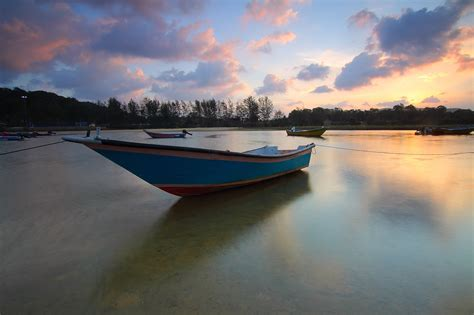 boat cloud free stock photo of beach boats clouds