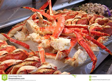 To Market Crab Tools by Crab And Clams On At A Fish Market Stock Photography