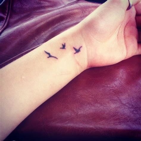 Bird Tattoo On Wrist Meaning | bird wrist tattoos designs ideas and meaning tattoos