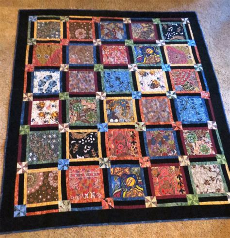 australian fabric quilt with black corduroy borders