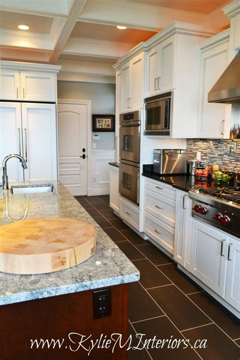 white glazed kitchen cabinets  coffered ceilings
