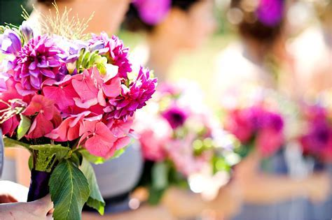 Bright vibrant wedding flowers at outdoor summer wedding