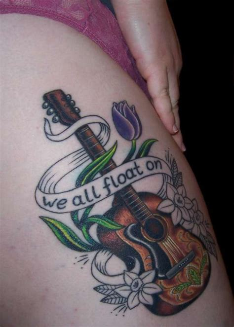 float on tattoo we all float on colored guitar with flowers on