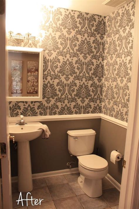 wallpaper bathroom designs small downstairs bathroom like the wallpaper and chair rail idea mostly gray with a bit of