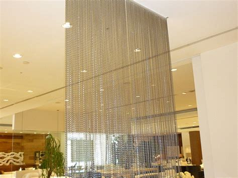 commercial room divider curtains scrim or strands of material suspended from the ceiling