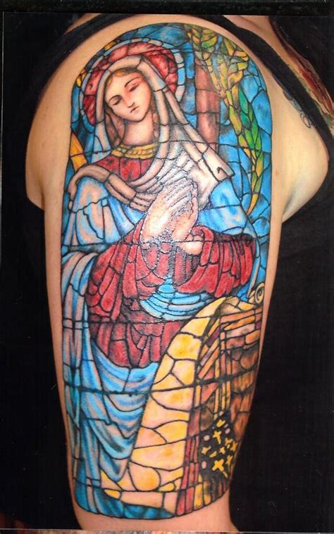 unique stained glass tattoos on full back body by mikael