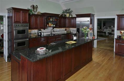Wood Cabinets With Black Appliances by Futuristic Black Slate Countertop For Kitchen Magic With
