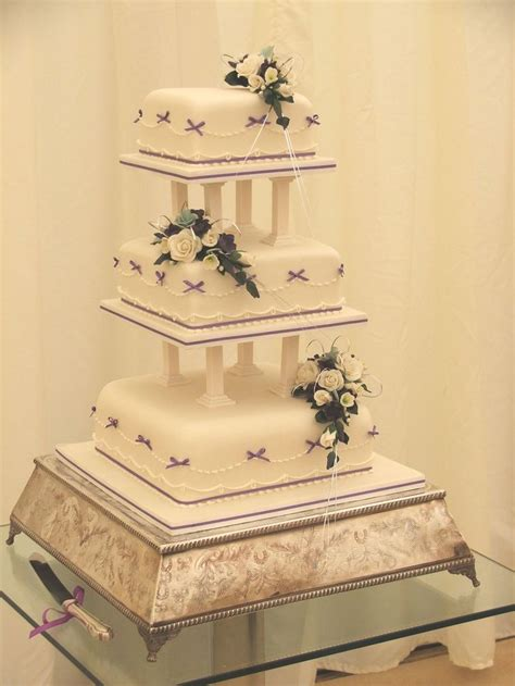 classic purple and white wedding cake with marzipan roses 57 best images about purple themed wedding cakes on pinterest