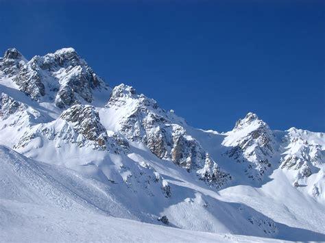 stock photo  snow covered mountain peaks