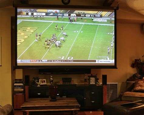 what size tv is best for my living room projectors vs tvs should you ditch your flat screen for a projector