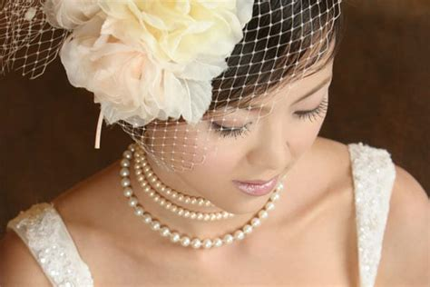 wedding updos with birdcage veil vintage wedding hair