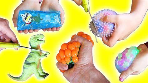 Squishy Dino Egg Slime cutting open squishy balls slime stress stretchy dinosaur glitter water