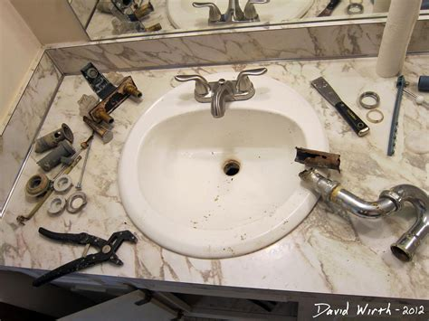 Replacing Plumbing by Bathroom Sink How To Install A Faucet