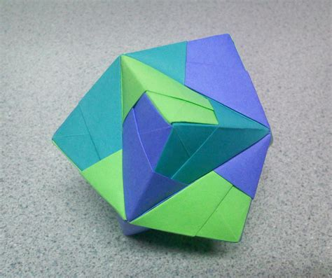 Top Origami - origami stellated octahedron top by theorigamiarchitect