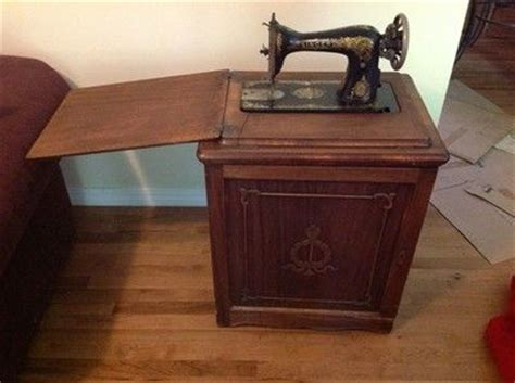 antique singer sewing machine in cabinet antique singer treadle sewing machine in enclosed cabinet