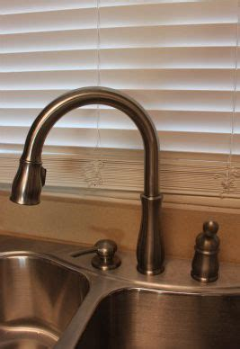 buying a kitchen faucet things to consider when buying a kitchen faucet