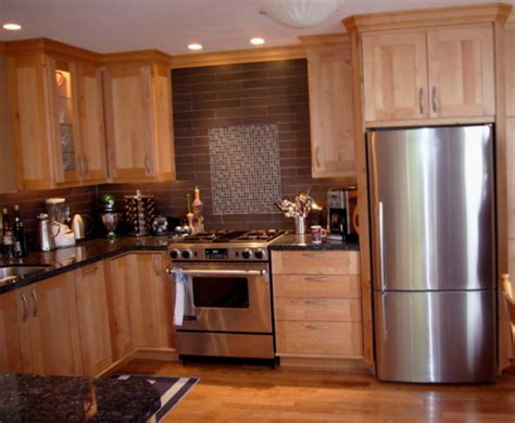 kitchen cabinets in western maple by tolka millwork