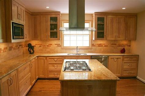 natural maple cabinets with granite countertops maple cabinets and a travertine backsplash bring natural
