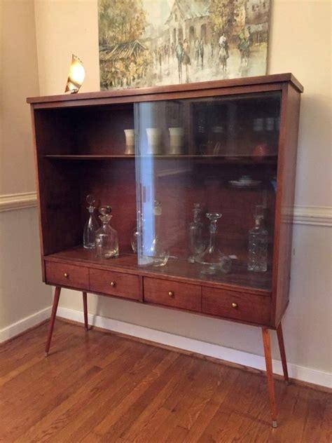 mid century walnut display cabinet with glass doors