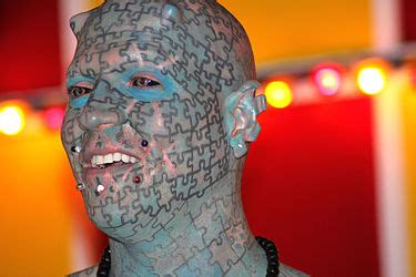 puzzle tattoo man 12 most extremely modified oddee