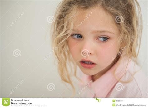 the youngest looking woman close up of a beautiful serious young girl stock photo