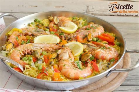cucinare la paella di pesce paella ricette della nonna