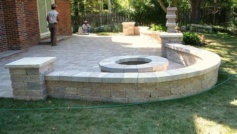 building a paver patio with retaining wall patio pit and sitting wall backyard ideas pits patio and this