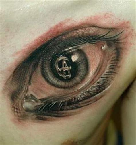 eye tattoo with skull skull in pupil of eyes tattoo on chest tattooimages biz