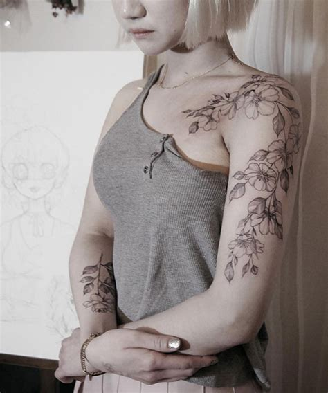 korean girl tattoo chic floral tattoo on shoulder and arm for korean girls