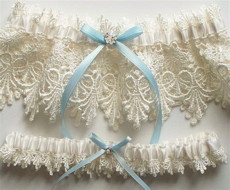 Set Garter wedding garter set with blue satin ribbon bow and by