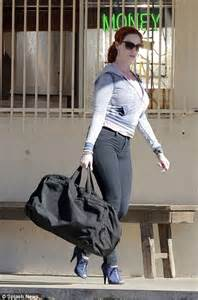 christina hendricks makes a clean getaway with a very big