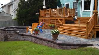 Wood Patios And Decks by Custom Built Wood Deck And Stone Patio Deck Patio