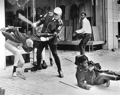Safe Inside The Violence a officer beats a youth during the violence that