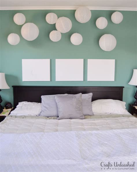 hanging lanterns in bedroom create a fun whimsical wall installation with paper lanterns