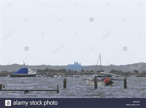 ferry boat norfolk spring high tide at morston harbour showing blakeney point