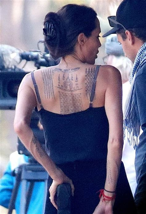 angelina jolie new tattoo persian angelina jolie has a few new tattoos we luv celebs