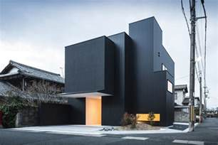 distinct black amp white exterior showcased by minimalist quot framing house quot in japan freshome com