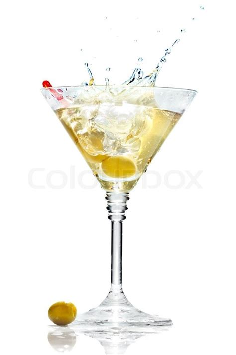 martini glass background olive splashing on martini glass isolated on white