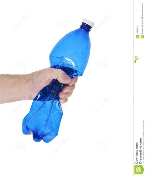 Iron Kitchen Island hands that crush a plastic bottle royalty free stock