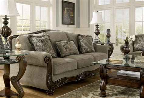 traditional sofas with wood trim signature design by ashley martinsburg meadow 5730038