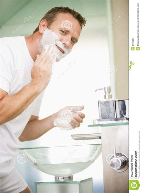 shaving in the bathtub man in bathroom shaving stock photos image 5930663