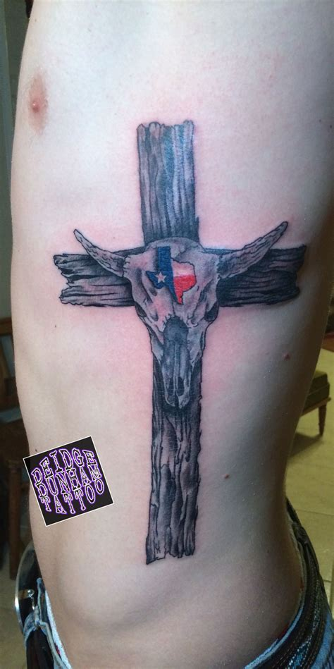 tattoo artist without tattoos designed drew and tattooed this wooden cross without the