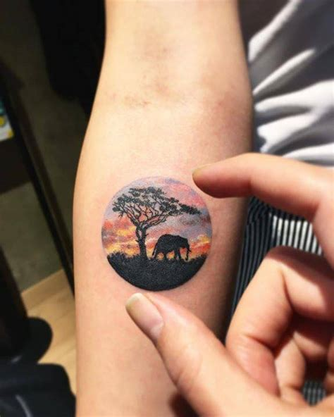 safari tattoo safari landscape circle on the right inner