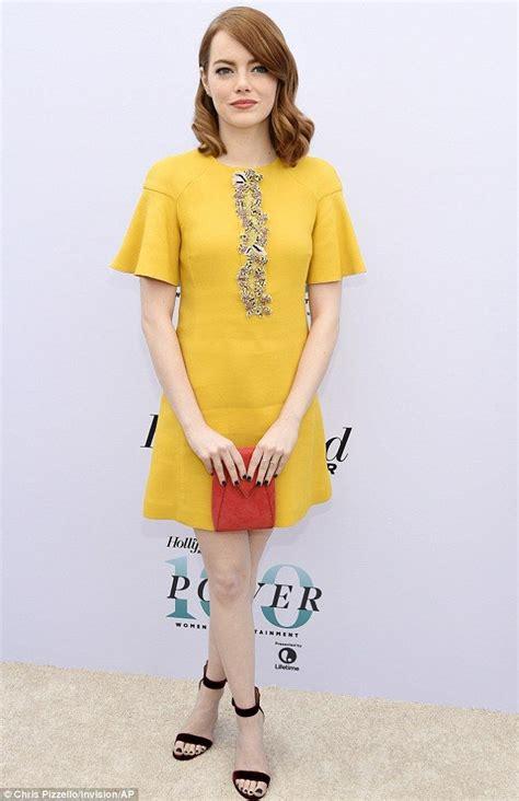 emma stone yellow dress emma stone turns winter into spring in scene stealing