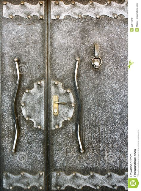 fragment of an metallic handmade door with doorknocker